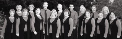 A group photo of Bells of the Cascades with Tim McDonough (back row, on the left side)